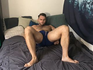 Blaze jerks his thick cock as the butt-plug stimulates him